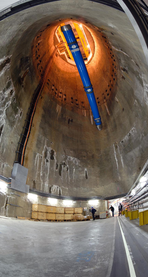 The final dipole magnet being lowers into the LHC tunnel