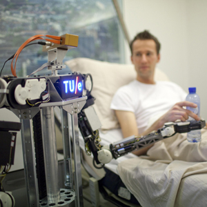 Robot connected to Wikipedia-like RoboEarth serves a drink of water to a hospital patient