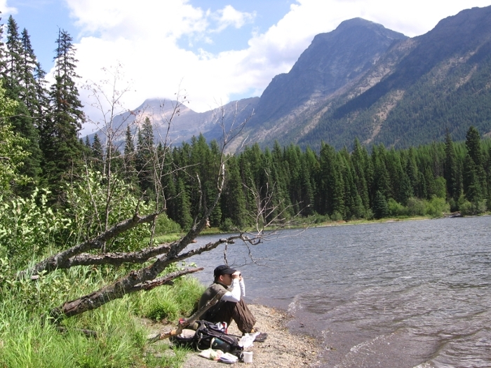 <strong>Two birds with one stone.</strong> What better way to see the outdoors than on a citizen science project? Here, a science volunteer gets away from it all while conducting a loon survey. Courtesy Glacier GPS. <a href=