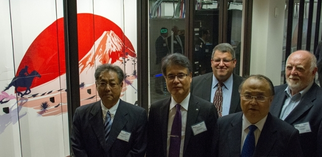 <strong>Global gathering. </strong>The Hikari project aims to demonstrate the potential of HVDC for data centers worldwide. Left to right: Munehiko Tsuchiya (NEDO), Atushi Ichihoshi (NTT Facilities, Inc.), Dan Stanzione (TACC), Tetsuro Amano (Consulate-General of Japan in Houston), Robert Hebner (UT Austin). Courtesy TACC.