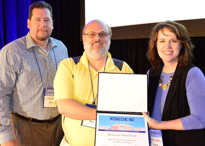 <strong>Making a MARC. </strong>Alexander Ropelewski accepts the award for best Workforce Development and Diversity Paper at the XSEDE16 conference from Kelly Gaither, XSEDE16 chair and John Towns, XSEDE principal investigator. Courtesy XSEDE.