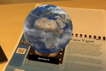 <strong>Real science. </strong> <a href= 'http://www.vis.ucar.edu/~meteo-ar/'>The Meteo Augmented Reality app</a> displays animated interactive virtual objects like globes and hurricanes. Courtesy UCAR; NCAR; CISL.