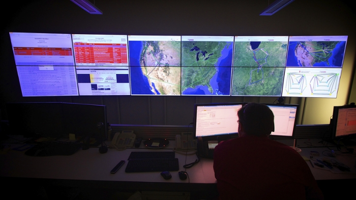 <strong>Over one billion served. </strong> The OSG Grid Operations Center at Indiana University has convenient access to XSEDE resources. Last year, OSG logged over one billion CPU hours. Courtesy Indiana University.