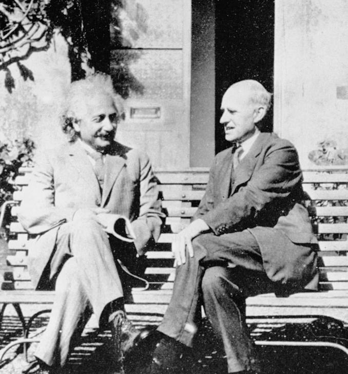 <strong>Birds of a feather. </strong> Albert Einstein and Sir Arthur Eddington chatting about genius stuff. Eddington's documentation of star positions before and after a solar eclipse demonstrated Einstein's theory of general relativity to be correct. Courtesy Royal Observatory Greenwich.