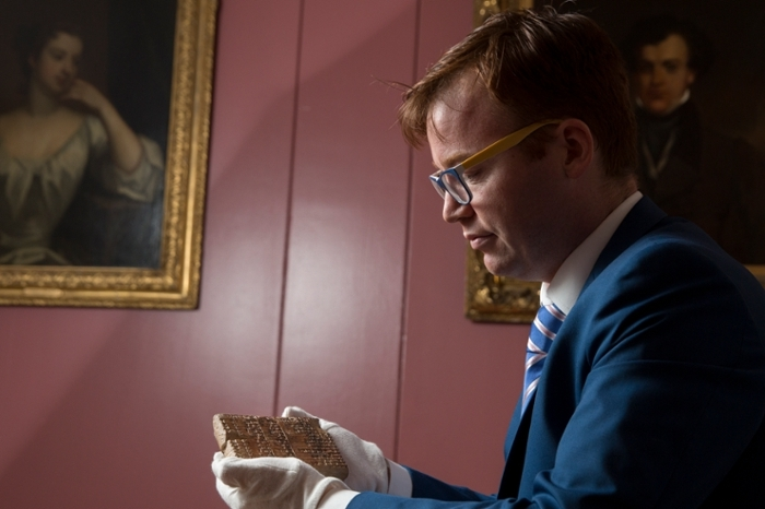 <strong>Math problem.</strong> UNSW mathematician Daniel Mansfield examines Plimpton 322, the tablet fragment that contains evidence of trigonometry and Pythagorean triples a thousand years earlier than previously known. Courtesy UNSW.