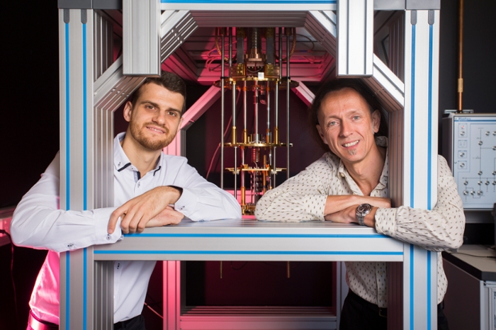 <strong>Quantum down under.</strong> Guilherme Tosi and Andrea Morello at the UNSW quantum computing labs with a dilution refrigerator, which cools silicon chips down to 0.01º above absolute zero. Courtesy Quentin Jones.