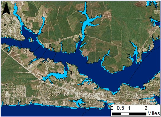 <strong>Who's zooming who?</strong> Magnified from the previous image, this shows flooding along the Newport River. The dark blue represents model-computed flooding for Matthew Advisory 27, while the light blue represents the flooding boundary produced by the enhanced resolution. Courtesy RENCI; Seahorse Coastal Consulting.
