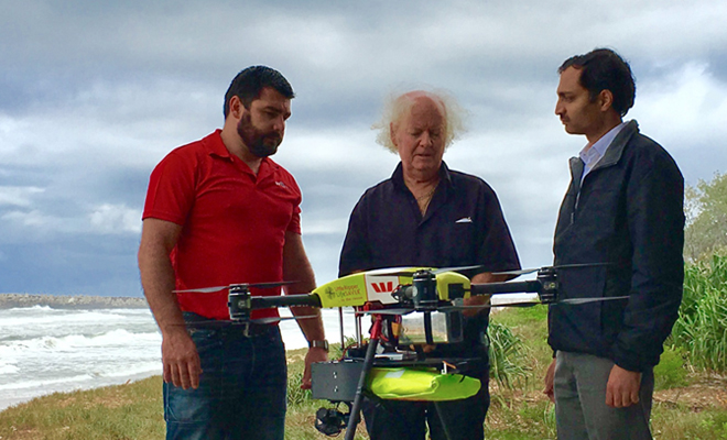 <strong>Beach buddies. </strong> Operations manager Ben Trollope, David Wright, mayor of Ballina Shire, and Nabin Sharma (from left) confer about the Little Ripper UAV, a drone that gathers video to identify sharks from the air. The SharkSpotter system uses this video to improve human safety without endangering marine life. Courtesy Little Ripper.
