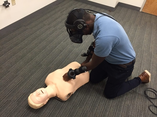 <strong>Staying alive.</strong> Augmented reality takes trainees into a real-life emergency scenario to better equip bystanders when an actual sudden cardiac arrest occurs. Courtesy Marion Leary; ImmERge Labs.