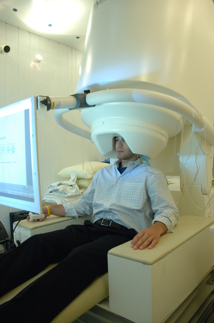 <strong>Silent and safe.</strong> Magnetoencephalographic (MEG) recordings measure magnetic fields caused by cooperative nerve-cell activity, but the technology requires supercomputers to generate images. Courtesy National Institute of Mental Health.