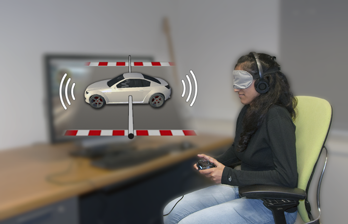 <strong>Navigating by sound.</strong> Parita Pooj, a blindfolded study participant, uses the sound slider. When she hears the car's sound move far toward the left, she will steer right to bring the sound back toward the center and away from the edge of the track. Courtesy Brian A. Smith/Columbia Engineering.