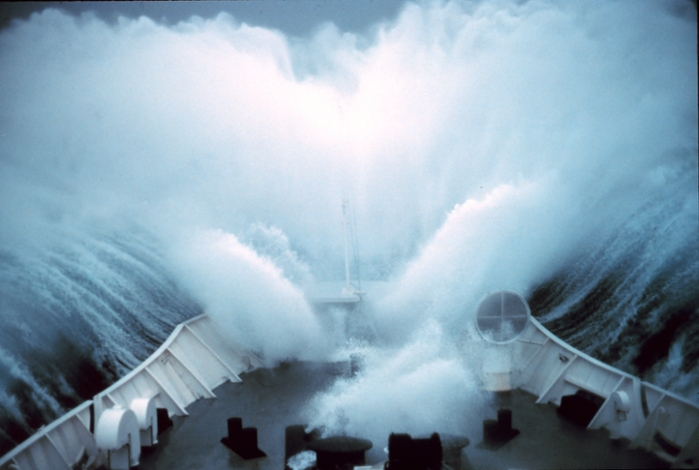 <strong>Violent flows</strong> such as ocean waves overtopping a ship's deck require lots of computing power to simulate due to their complexity. Courtesy NOAA.