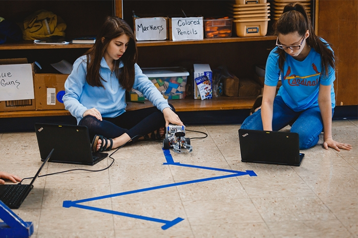 <strong>Zig zag.</strong> One part of the curriculum includes programming the Mindstorms to follow a path laid out in blue tape. Courtesy Indiana University.