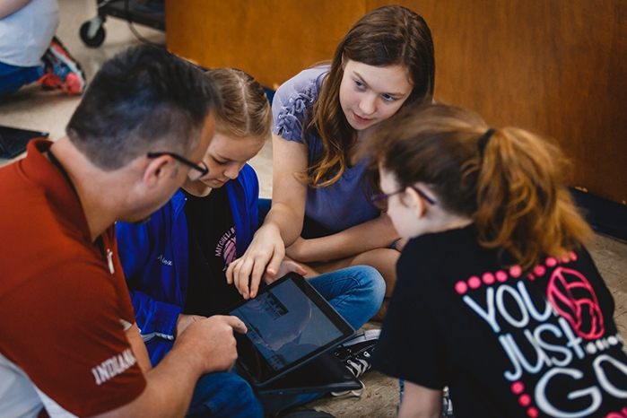 "<strong>Digital natives.</strong> There's a lot vying for students' attention these days, but the robotics unit seems to captivate everyone. ""Using the Mindstorm robots definitely helped me reach all students,"" said Glassco. Courtesy Indiana University."