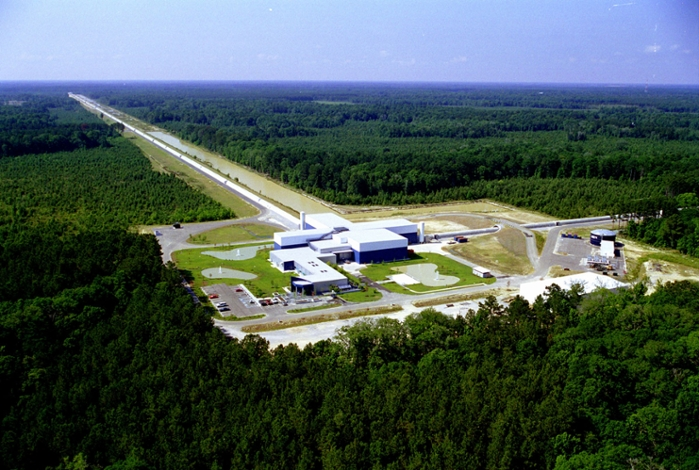 <strong>Ripples in space-time.</strong> LIGO's multi-kilometer-scale gravitational wave detectors use laser interferometry to measure the minute ripples in space-time caused by passing gravitational waves from cataclysmic cosmic sources such as the mergers of pairs of neutron stars or black holes, or by supernovae. Courtesy Caltech/MIT/LIGO Lab.