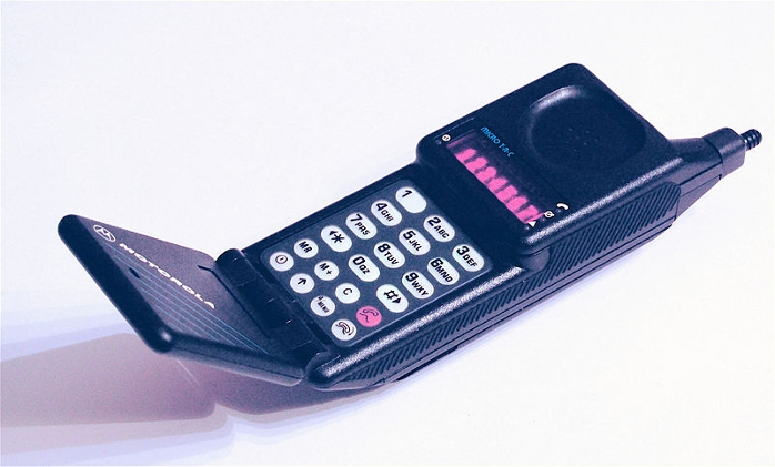 <strong>The first mobile phone worthy of the name.</strong> The 1989 Motorola MicroTAC 9800x, with a flip-up mouthpiece and retractable antenna, weighed less than one pound and was designed to fit in a shirt pocket. Courtesy Redrum0486. <a href='https://creativecommons.org/licenses/by-sa/3.0/deed.en'>(CC BY-SA 3.0)</a>