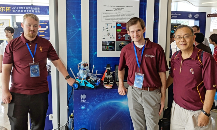 <strong>Blue ribbon.</strong> ASU students Richard Simpson and Stephen Lockhart and mentor Yinong Chen took first place at the 2018 Intel Cup in Shanghai for their prototype of a robotic guide dog. Courtesy Yinong Chen.