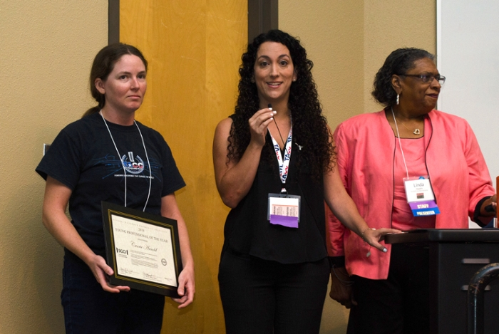<strong>Future feature.</strong> Linda Hayden (r.) of Elizabeth City State University and Maytal Dahan (center) of TACC present a Young Professional of the Year award to TACC software engineer Carrie Arnold (l.) Courtesy Jorge Salazar, TACC.