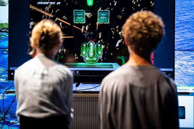 <strong>If you look away, you crash your spaceship.</strong> Gaze-driven games harness the connection between eye movement and attention, training players that better engagement gets better results. Courtesy Alex Matthews, UC San Diego Qualcomm Institute.