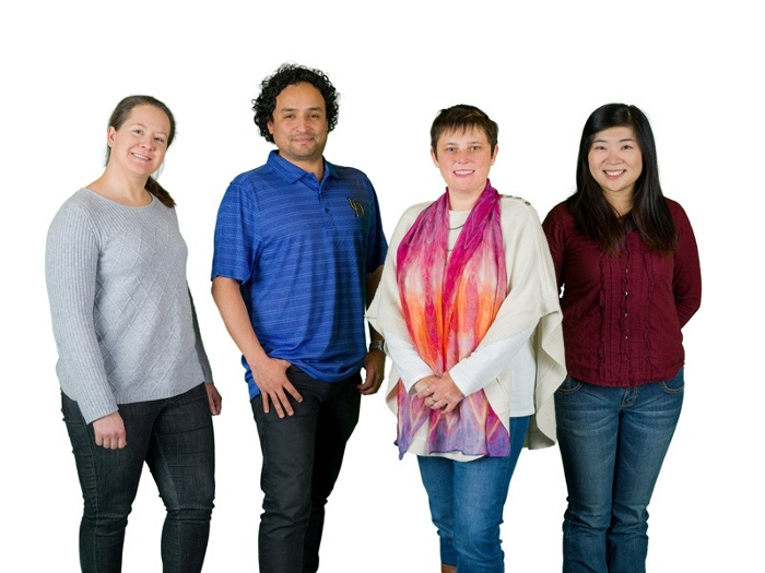 "<strong>Research team members</strong> (from left) NMR spectroscopist Caitlin M. Quinn, faculty members Juan Perilla and Tatyana Polenova and doctoral student Mingzhang ""Maple"" Wang. Courtesy University of Delaware."