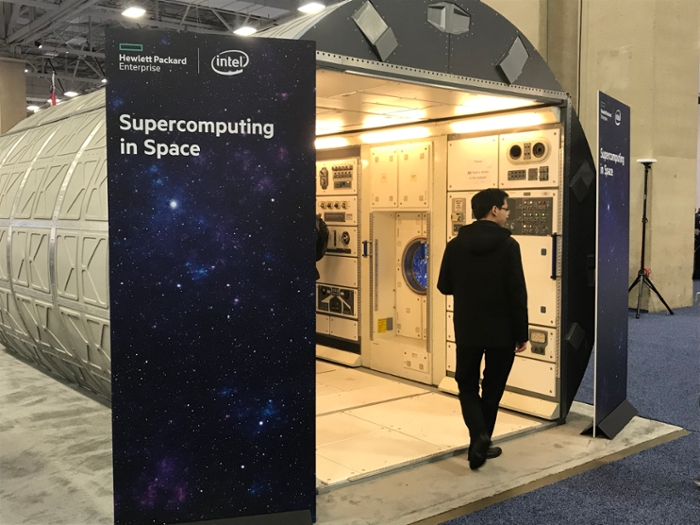 <strong>Space walk.</strong> Conference attendees explore the model of the ISS at HPE's booth at SC18, the world's biggest supercomputing conference, held in Dallas, TX in November 2018. Courtesy Alisa Alering.
