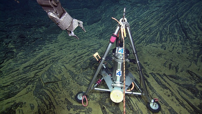 <strong>Tracking undersea eruptions.</strong> This Bottom Pressure and Tilt Meter installed at the summit of the Axial Seamount measures the rise and fall of the seafloor due to melt migration in the subsurface. Courtesy NSF-OOI/UW/CSSF. <a href='https://creativecommons.org/licenses/by-nc-nd/3.0/us/'>(CC BY-NC-ND)</a>
