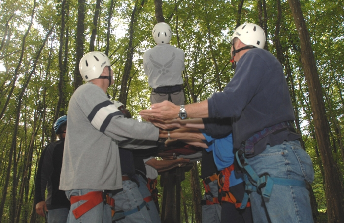 <strong>Trust fall.</strong> A new study concludes that video games may be as effective at gettting people to work together effectively as more traditional team-building activities involving hardhats and rope climbs. Courtesy US Air Force/Senior Airman Josie Kemp.
