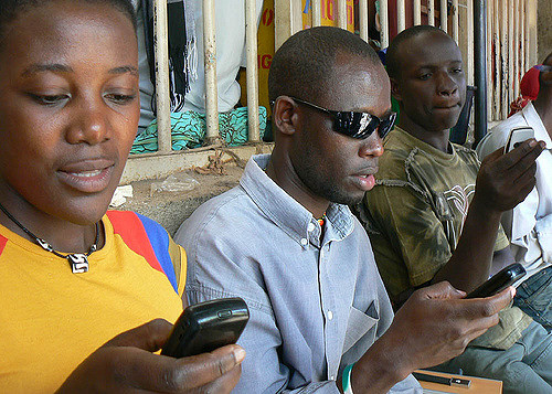 <strong>Growth sector.</strong> Mobile phone use in Tanzania has surged in the past decade and 45% of Tanzanian adults use mobile money. Courtesy Ken Banks, kiwanja.net. <a href='https://creativecommons.org/licenses/by/2.0/'>(CC BY 2.0)</a>