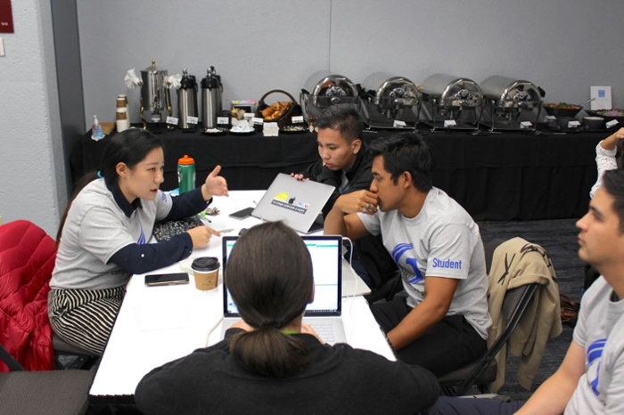 <strong>48-hour challenge.</strong> The student competitors had only 48 hours to do all of their research and come up with a 30-minute presentation before a panel of judges at the SC18 conference in Dallas, TX. Courtesy Computing4Change.