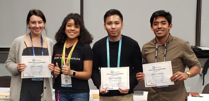 "<strong>The winning Computing4Change team</strong>, L-R: Claire Fiorino, Erika Bailon (Mentor), Nilo Espinoza, and Hoano Rosario. Not pictured: Peizhu ""Pam"" Qian. Courtesy Computing4Change."