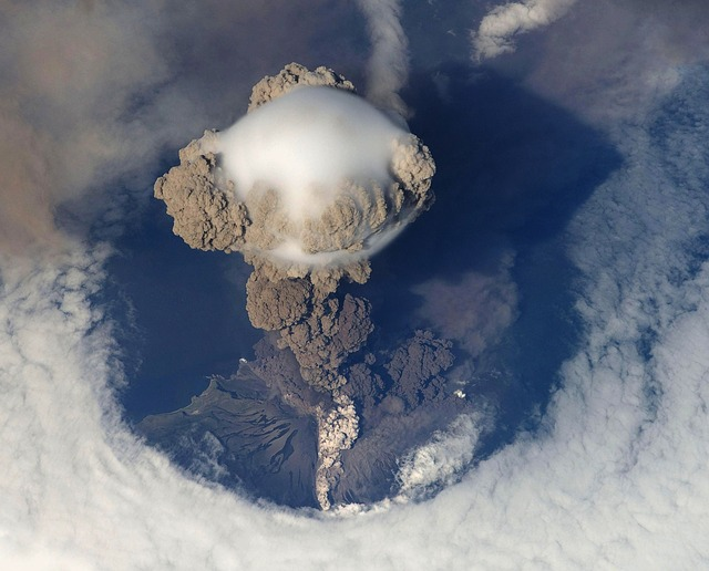 <strong>When a volcano erupts</strong>, sulfur compounds are introduced to the upper atmosphere. The tiny particles are highly reflective and send a percentage of sunlight back into space, causing the planet to cool.