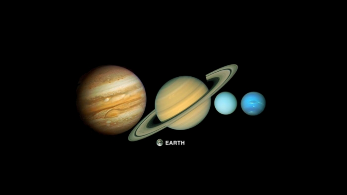 <strong>Big brothers.</strong> Large planets like Jupiter and Saturn protect smaller planets from meteors and other space hazards, like a big brother who prevents bullies from beating you up on the playground. Courtesy NASA/JPL.
