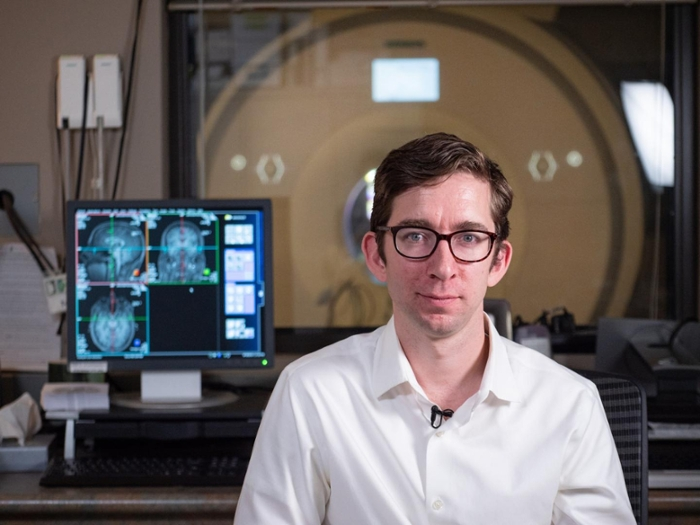 <strong>Investigating emotion.</strong> Postdoctoral researcher Kragel combines machine learning with brain imaging to learn more about how images impact emotions. Courtesy Glenn Asakawa/CU Boulder.