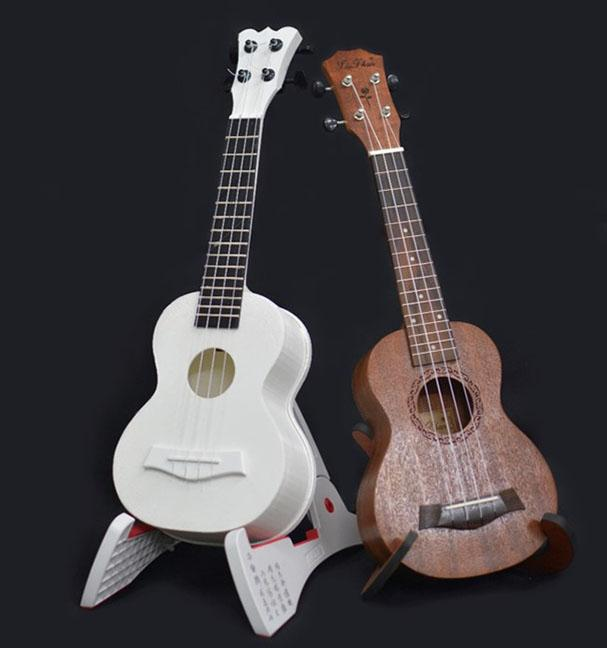 <strong>The traditional wooden ukulele</strong> on the right produces louder sounds and  more high-frequency vibrations than the 3D printed one on the left. Courtesy Xiaoyu Niu.