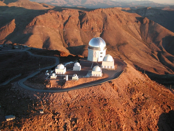 <strong>High and dry.</strong> The Blanco 4m telescope at the Cerro Tololo Inter-American Observatory in northern Chile is ideally situated for observing the Southern sky without interference from city lights or air turbulence. Courtesy DES.