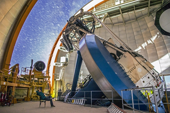 <strong>The Dark Energy Camera</strong>, mounted on the Blanco telescope, recorded images of hundreds of millions of galaxies in an effort to find patterns of cosmic structure that may reveal the nature of dark energy. Courtesy Reidar Hahn, Fermilab.