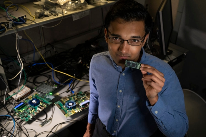 <strong>Nabil Imam</strong> holds a Loihi neuromorphic test chip in his lab. He and his colleagues from Cornell University are building mathematical algorithms that mimic what happens in your brain's neural network when you smell something. Courtesy Walden Kirsch/Intel Corporation.