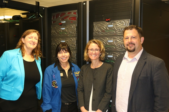 <strong>Carolyn Ellis</strong> (l), controlled research program manager at Purdue University with astronaut Mary Ellen Weber, Theresa Mayer, and Preston Smith, on a data center tour with the Weber computing cluster at Purdue. Courtesy Purdue University.