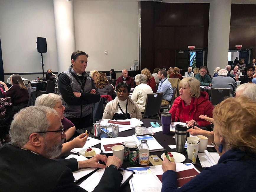 <strong>Preparing for real-world scenarios.</strong> Cinda Haff helps election officials talk through the tabletop exercises concerning power outages, stolen poll books, and other cyberattacks.