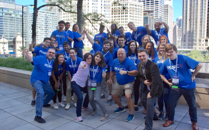 <strong>Bright side.</strong> A virtual conference this year meant that some people who had hoped to attend in the past finally got their chance. Here, the 2019 crew shows off in Chicago. Courtesy PEARC.